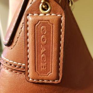 Tan leather Coach purse.